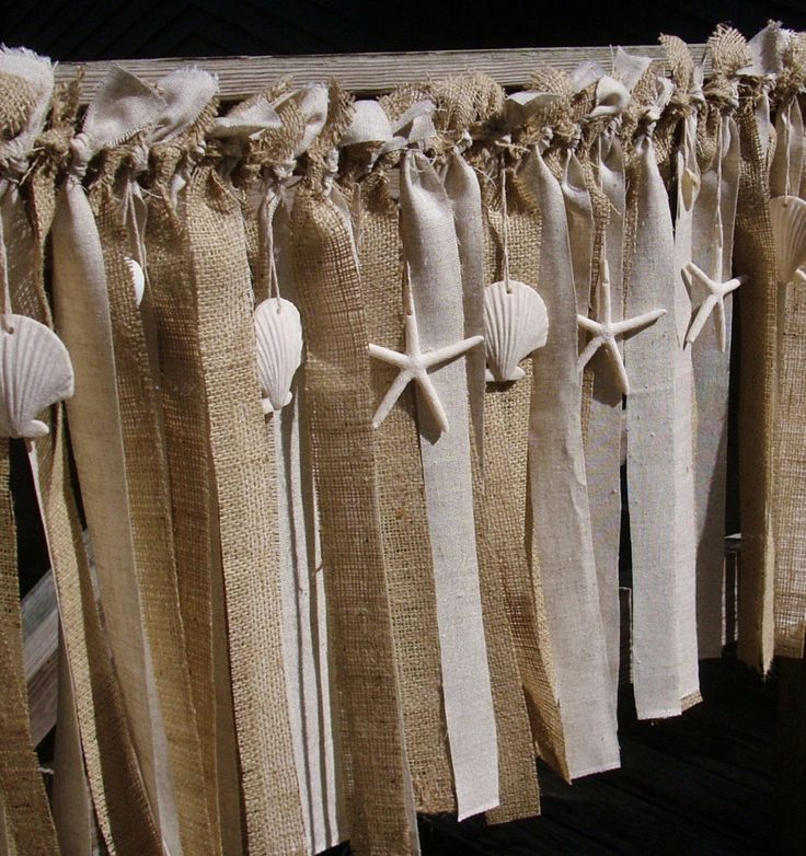 beach burlap garland- etsy. Could customize. I was thinking burlap shower curtain with this as top.