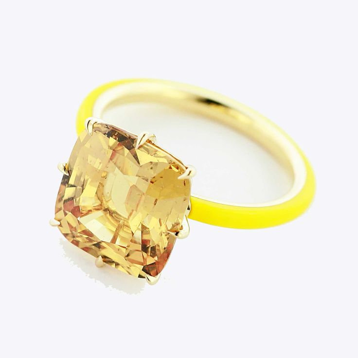 Buy me Taffin 18ct gold ring featuring a large yellow sapphire on a rose gold band covered in high-tech ceramic.