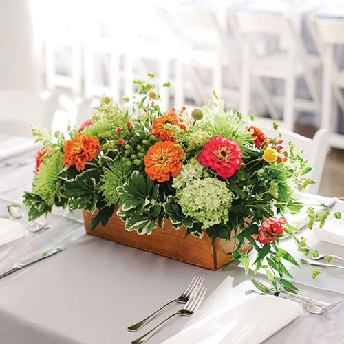 summer wedding centerpiece with zinnias