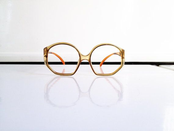 Vintage oversized designer glasses frames from the 1970s by Christian Dior. Translucent yellowish frames with pale orange ear pieces. In excellent