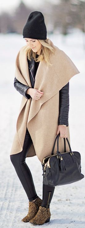 Love this sleeve-less coat! Throw a black leather belt around it and it's a dream come true