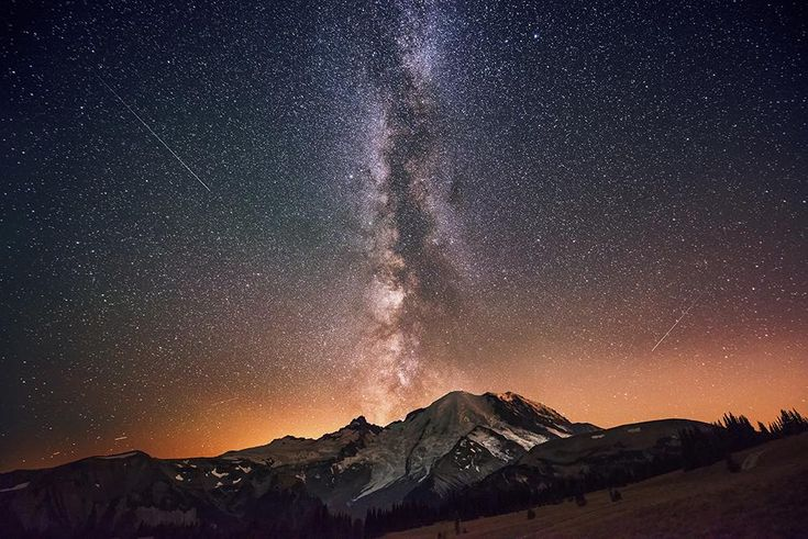 """The Milky Way Galaxy Exploding from Mount Rainier --David Morrow The photographer captured this image of the Milky Way rising up from behind Mount Rainier with a Nikon D800. """"The stars almost looked as though they were erupting from the mountain and I knew this was a moment in time that I had to capture,"""" Morrow says."""