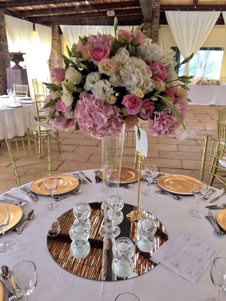 Love these beautiful pastel hydrangea and rose talk centerpieces we made for a wedding. Created by Bliss Floral Creations