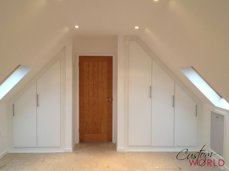 White hinged wardrobe in a sloped ceiling bedroom