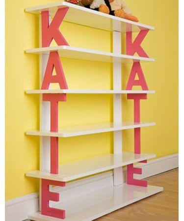 Name Shelf- great inspiration to make one for your kid's room. Paint some wood letters or another idea could be to paint some paper mache letters and use as book ends too!.