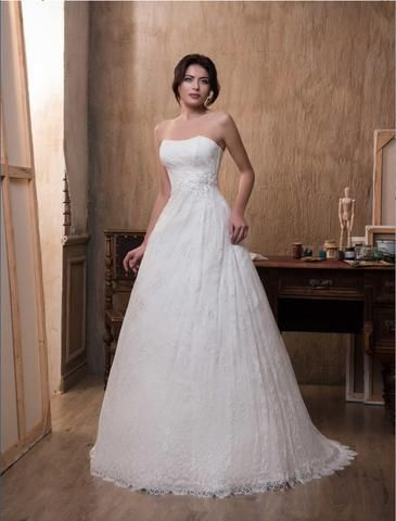 Magdalena - Elegant A-line full lace wedding dress, with slight roughing around the waist area with flower detail.