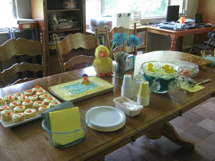 I did a rubber duckie theme for my grandson's baby shower. Got the punch from pinterest! Cake was a bathtub with rubber duck and cupcakes were duck faces made with candy by @Kylin. Napkins, plates, cups, baskets bought at Dollar Tree. So cheap and so fun!