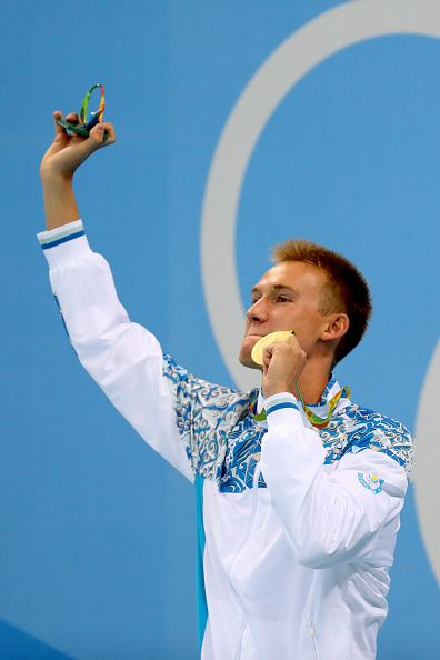 #RIO2016 Gold medalist Dmitriy Balandin of Kazakhstan poses on the podium during the medal ceremony for the Men's 200m Breaststroke Final on Day 5 of the Rio...