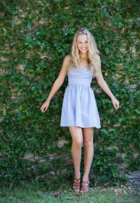 Always smiling, lovely Madison Iseman. I love the pretty blue dress and her beautiful type of legs. Sal P.