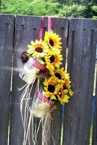 These cute and inexpensive tin can decorations are perfect for a country themed wedding. Just clean ordinary tin cans and hot glue a square of styrofoam into the bottom, adding whatever silk flowers you choose.