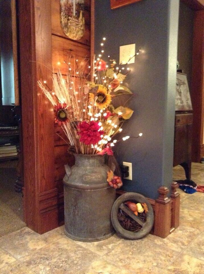 Milk Can Lighted Floral Arrangement. Add a string of lights could change out the arrangement for the season or holiday.