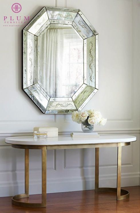 Exquisite Foyer Features Octagon Antiqued Beveled Mirror Over Antique Brass Console Table With