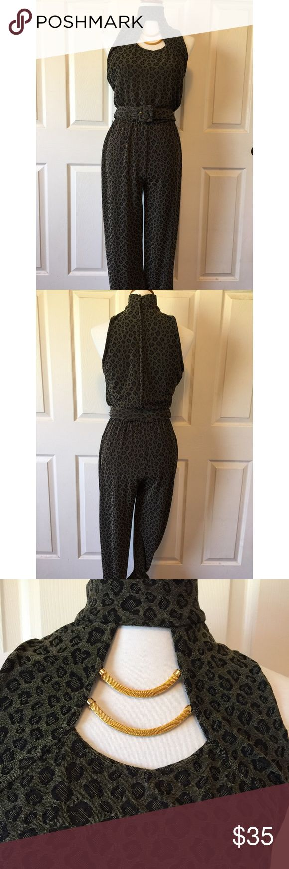 """PG COLLECTIONS JUMPSUIT Beautiful animal print on this jumpsuit from 🔹PG Collections Designed by Ginger Root, California. 🔹Excellent condition🔹Size 10: 38"""" bust, 60"""" long, 35"""" inseam, 30"""" elasticize waist 🔹Fabric:44% Nylon, 50% polyester, 6% spandex 🔹Dry clean only🔹No trades🔹Smoke free home🔹Bundle discount: 10% off two, 15% off three🔹Thank you for visiting💕 PG Collections Pants Jumpsuits & Rompers"""