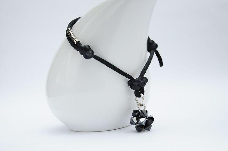 Satin cord bracelet - bransoletka wykonana jest z czarnej satyny i ozdobiona kulką z kryształków SWAROVSKIEGO - BICONE - JET HEMATITE. Dodatkową ozdobę stanowią japońskie koraliki MIYUKI w kolorze srebrnym.