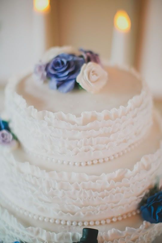 Ruffled Fondant Pearls And Roses In Shades Of Purple Adorn The Wedding Cake