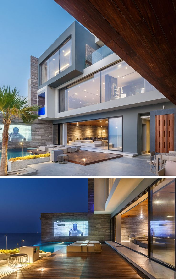 At night, movies can be projected onto the wall for outdoor entertaining at this house.