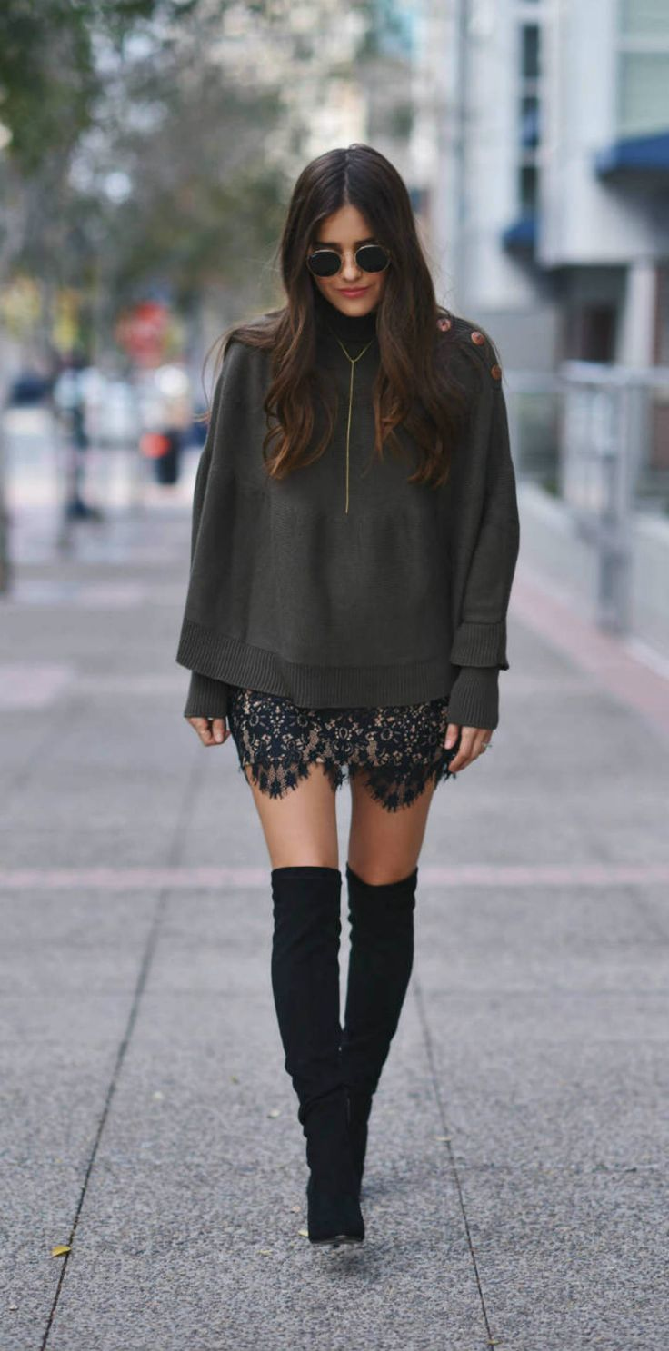 Blank Itinerary looked so stylish in thigh high boots, a lace skirt, and a sweater.
