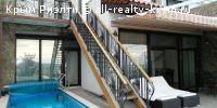 #Ялта #Сдам в аренду: Таунхаус в Гурзуфе, Ялта, апартаменты с видом на море.  Таунхаус находится на закрытой охраняемой территории элитного коттеджного поселка Вилла Роз. В цоколе гараж на два автомобиля. Перед входом открытый бассейн. На первом этаже: гостиная, сауна, с/у, прачечная. Второй этаж апартаментов в Гурзуфе: холл с камином, финская сауна, кухня, ванная комната. Третий этаж таунхауса: спальня, детская комната, гостиная, ванная комната, терраса с видом на море и Гурзуф…