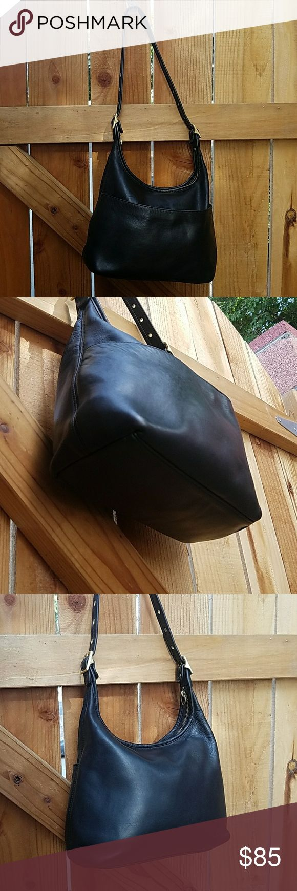 "Vintage Coach Black Leather Legacy Hobo This Legacy collection leather hobo bag with brass hardware is very roomy! Inside zipper pocket. Has a outer pocket for easy access to items like your phone/keys! Strap at longest 25"" Made in USA # KOD-9058  Restored- Cleaned, reshaped, redyed, sealed, conditioned to make as new as possible!  Vintage Coach, Dooney, Frye & other great finds in my closet💕 Coach Bags"