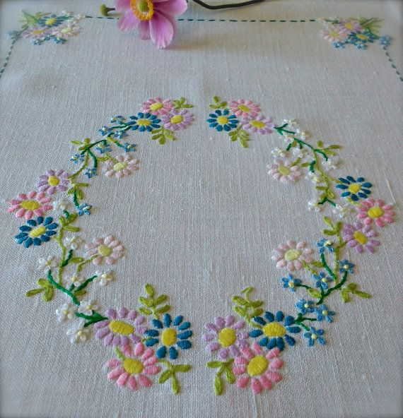 Check out this item in my Etsy shop https://www.etsy.com/uk/listing/475721697/pretty-hand-embroidered-floral-vintage