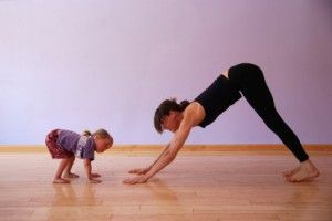 """Mommy and Me' Yoga Downward Dog Position"