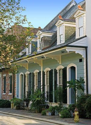 Creole cottage, beautiful roof overhang with Victorian salvaged brackets