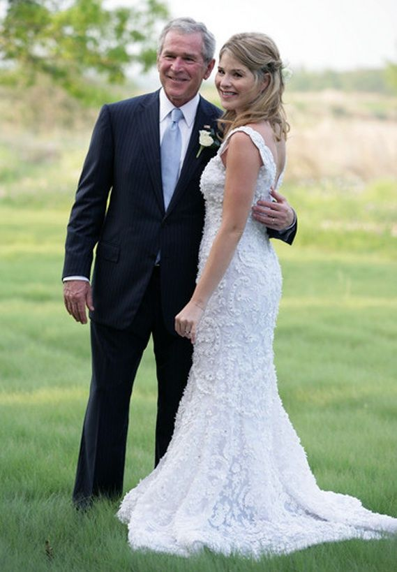 President George W. Bush poses with one of his twin daughters, Jenna, on her wedding day, May 10, 2008. The bride, who went veil-less wore a beautifully embroidered mermaid-style organza gown with matte beading and a sweep train by Oscar de la Renta. She had 14 bridesmaids and her twin, Barbara, was maid of honor. The bridesmaids, wore silk cocktail-length dresses in seven different colors that match the palate of Texas wildflowers - blues, greens, lavenders and pinky reds.