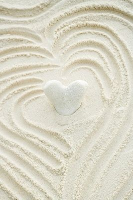 Draw a heart in the sand