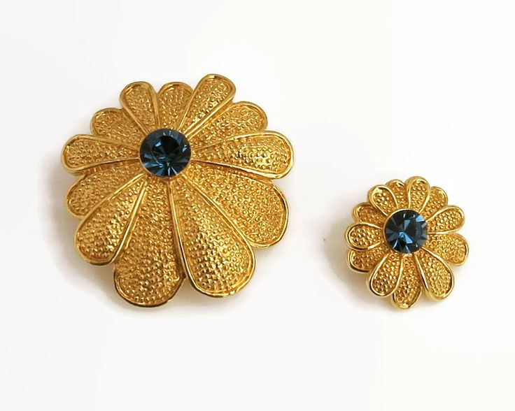 2 matching gold tone flower brooches with blue glass centers and 11 textured petals each, 2 different sizes, C-clasps, circa 1960s by CardCurios on Etsy