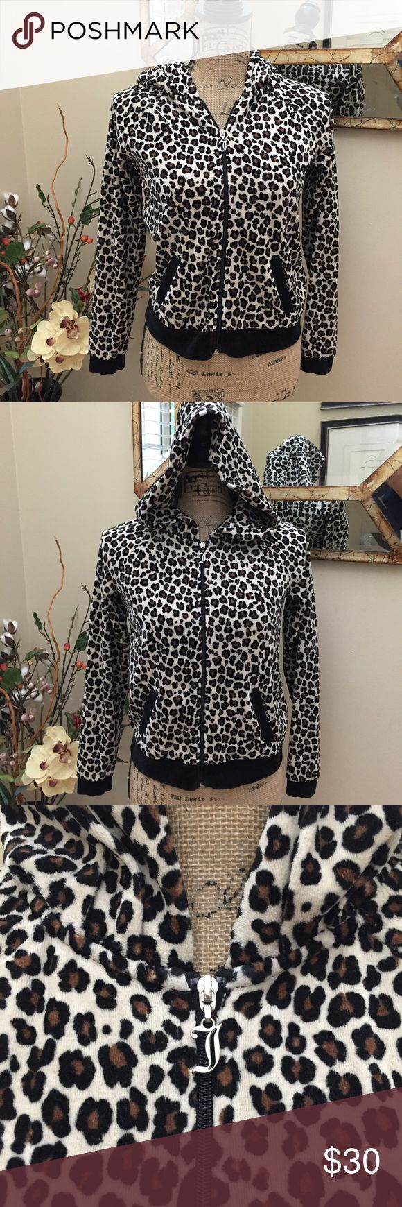 """🌟Juicy Couture full zip animal print hoodie. 🌟Juicy Couture full zip animal print hoodie. This is a super soft hoodie with front pockets. On trend fall animal print. Perfect for fall to winter layering. Wear to the office the park or on a date. Very versatile. Preloved in excellent condition. Pit to pit at the back is 15"""". Length 22"""". Juicy Couture Tops Sweatshirts & Hoodies"""