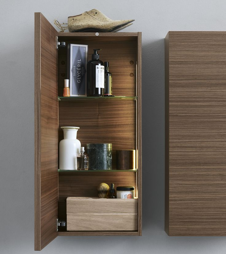 Zaro brushed walnut wall cabinet with built-in lighting.