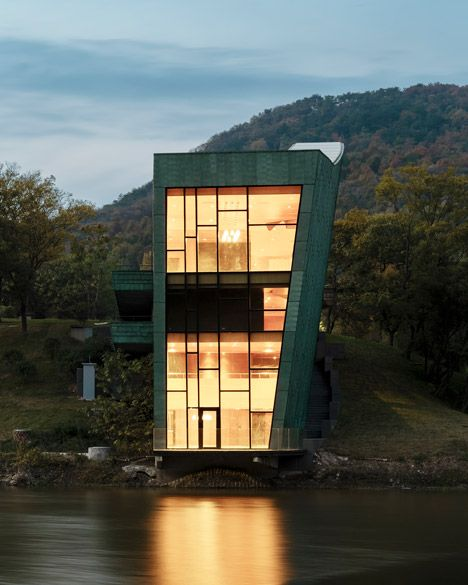 This residence has a green copper exterior and is built in the grounds of Steven Holl's Nanjing Sifang Art Museum
