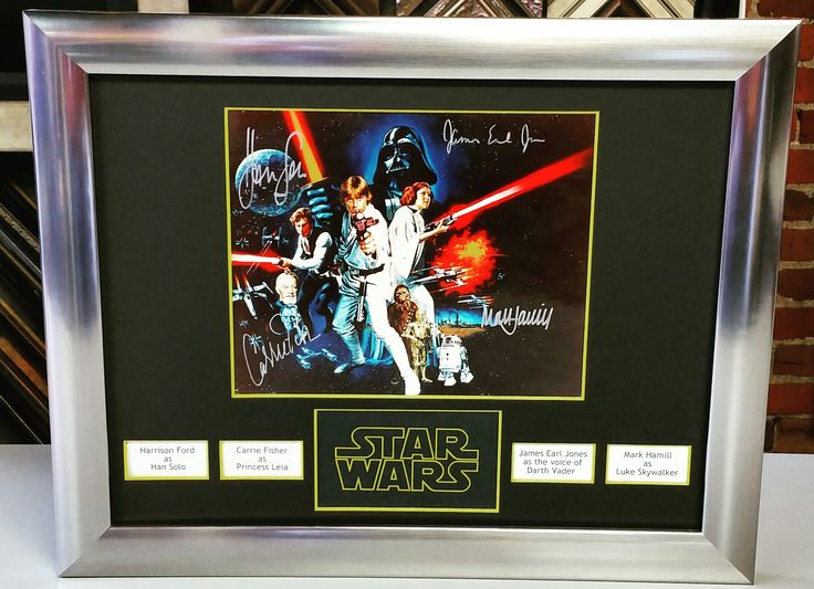Custom framed Star Wars print signed by Harrison Ford, Carrie Fischer, James Earl Jones and Mark Hamill! Come see why collectors frame their prized memorabilia with FastFrame of LoDo! #art #pictureframing #customframing #denver #colorado #starwars