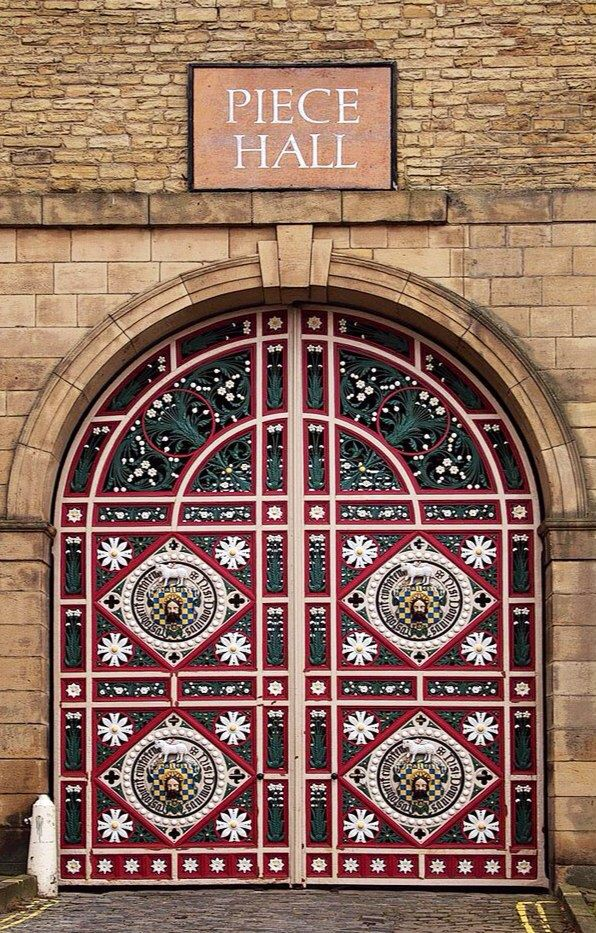 "This beautiful door looks like a quilt, so how appropriate it opens to ""Piece Hall!"" :-) (Halifax, West Yorkshire, England)"
