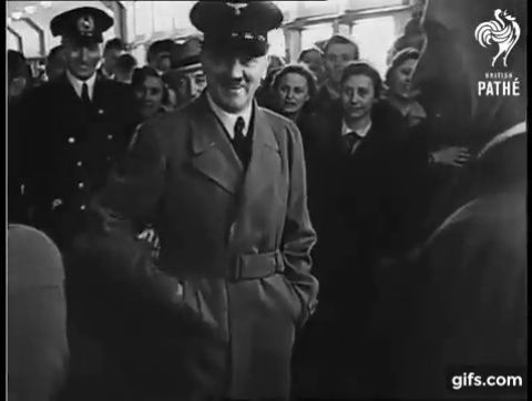 """Hitler on board the vessel Robert Ley in 1939. He's wearing his black """"yachting"""" cap."""