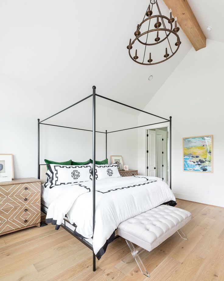 come see this modern farmhouse featuring a master bedroom with an iron canopy bed and white - Gotische Himmelbettvorhnge