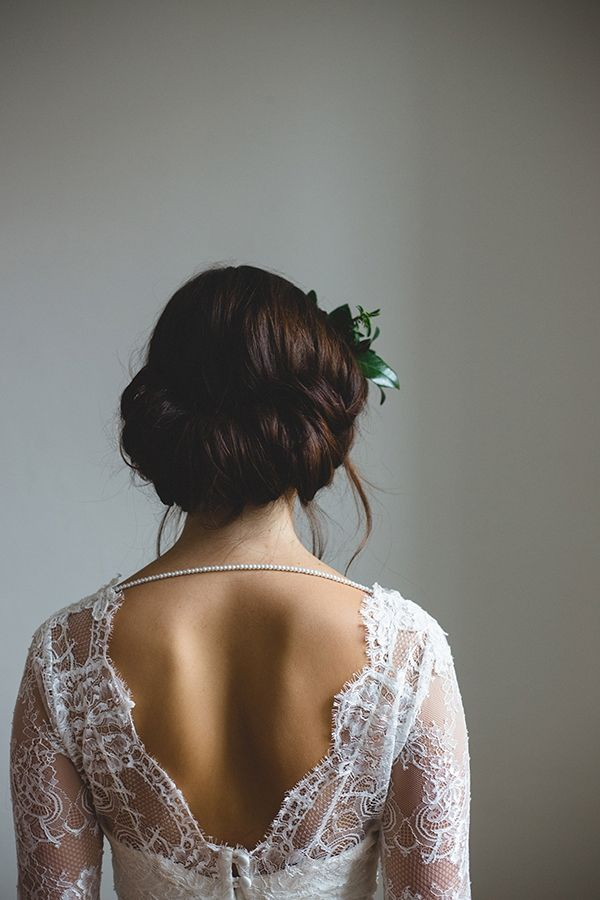 A delicate strand of pearls adds visual interest to the back of this demure lace dress. We must also note the gorgeous Gibson tuck! | Photo by Frances Beatty