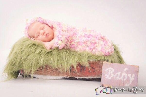 Newborn in baby pod