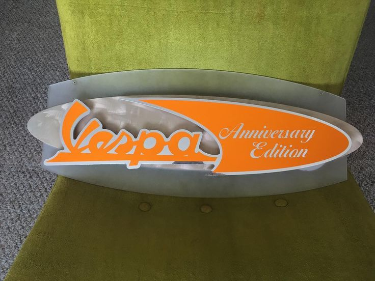 A Retro themed Vespa Sign that was designed and created by Eric McGrew