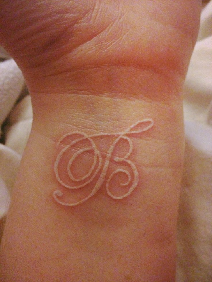 white-wrist-initial-tattoo