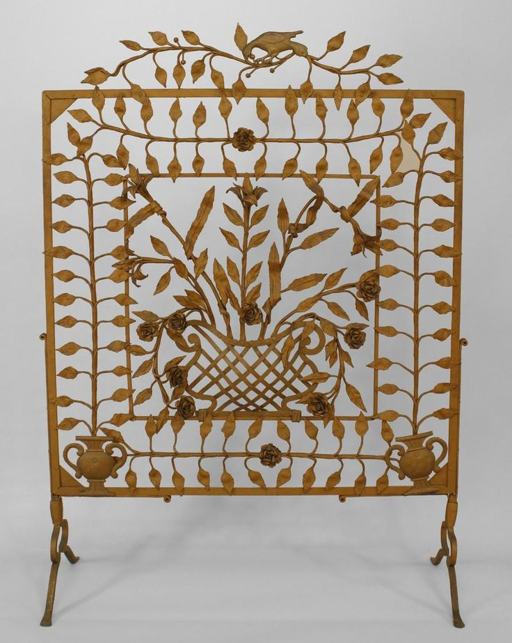 American Victorian painted wrought iron large filigree fire screen with floral design of leaves and flowers with a figure of a bird on top. I definitely want this.