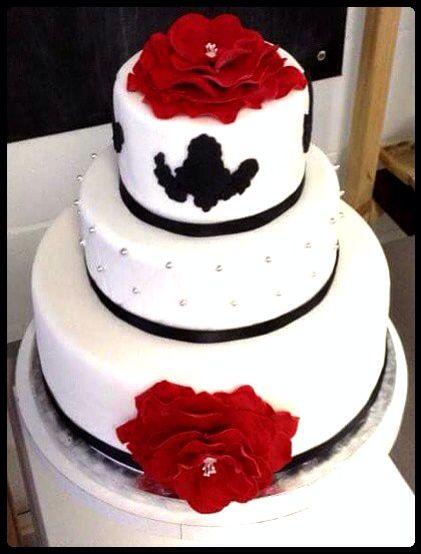 Stunning red white and black wedding cake