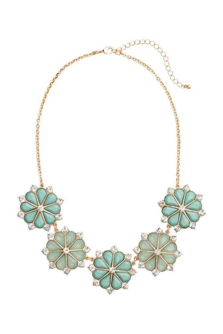 Collana corta: Collana corta in metallo con pendenti a forma di fiore con strass. Lunghezza regolabile, 46-54 cm.