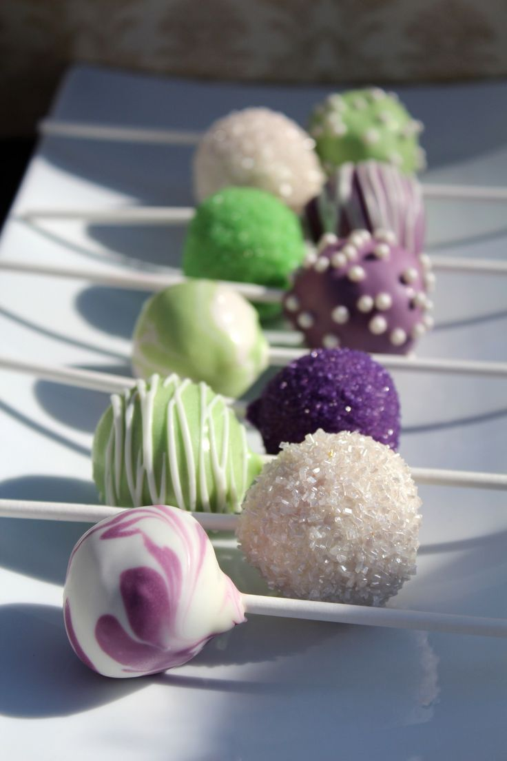 Purple and Green wedding cake pops for you @Amy Collins except make them teal and yellow!! Maybe for wedding shower.