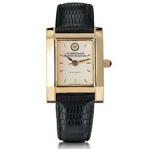 """USMMA Women's Gold Quad with Leather Strap by M.LaHart. $299.00. Scratch-resistant sapphire crystal.. Swiss-made quartz movement with 7 jewels.. Water-resistant to 30 meters.. Jewelry-grade gold finish with Swarovski black crystal cabochon.. Cream dial with hand-applied, faceted markers.. U.S. Merchant Marine Academy women's gold watch featuring USMMA seal at 12 o'clock and """"U.S. Merchant Marine Academy"""" inscribed below on cream dial."""