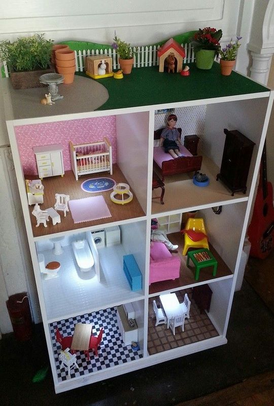 book shelf turned doll house. Very cool! Love the attention to detail and how they used battery LED lights for lighting in each room.