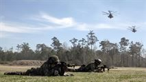 A Royal Dutch Marine with the Royal Netherlands Marine Corps secures a rope attached to a CH-53 E Super Stallion as the helicopter lands at the Expeditionary Operations Training Group compound at Stone Bay aboard Marine Corps Base Camp Lejeune, North Carolina, March 17, 2015. The helicopter hovered 50 feet above the ground with a rope hanging from a hole in the belly of the aircraft, which Royal Marines used to quickly escape and slide down the rope to safely reach the ground.#USMC…