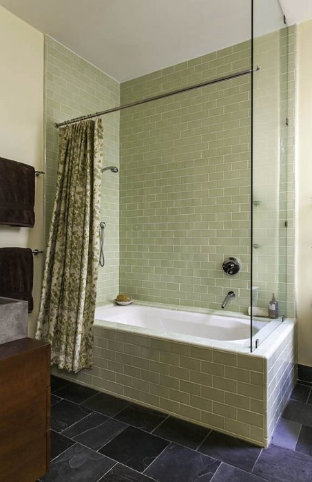 A custom shower curtain compliments the tile work in this contemporary San Francisco  bathroom.