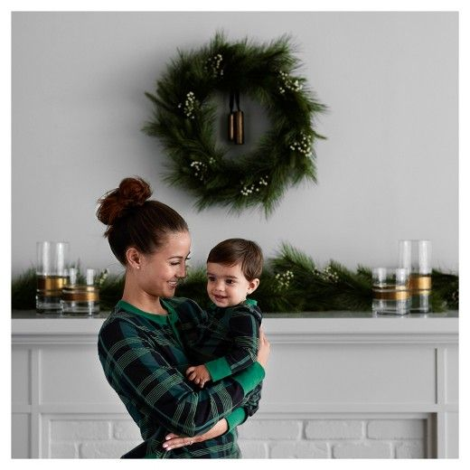 Being comfy doesn't have to be costly this holiday. Create cozy and camera-worthy moments with our family plaid pajama sets. For the perfect picture backdrop, decorate with wreaths, garland and brass-wrapped vases—green meets serene. Winterize Your Mantel Collection - Hearth & Hand™ with Magnolia [affiliate] Chip and Joanna Gaines