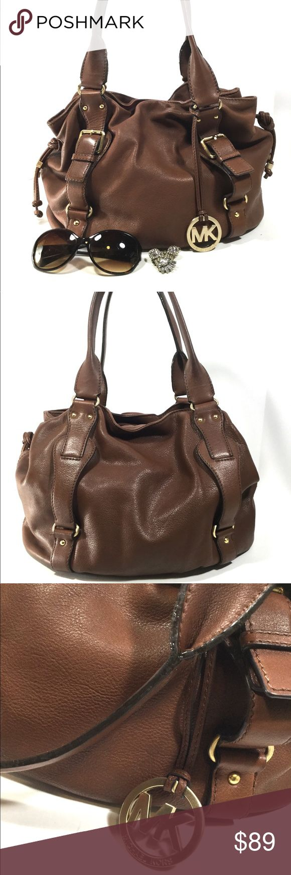 Michael Kors Drawstring Brown Handbag Beautiful leather Michael Kors bag. Shows minor wear on the outside. Few light spots on bottom. Edging on handle shows wear but isn't cracking and it still functional. Interior is in great condition. Michael Kors Bags Satchels